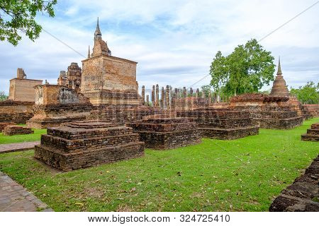 poster of Sukhothai Historical Park, Temple Ruins Of Wat Mahathat In The Sukhothai Historical Park, Thailand.