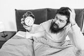 Get Up With Alarm Clock. Overslept Again. Tips For Waking Up Early. Man Bearded Sleepy Face Bed With poster
