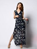 Sexy Pretty Woman Pretty Face Wearing A Dark Silk Floral Dress With A Belt. Long Slim Body Shape Cos poster