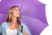 Blond woman with purple umbrella open