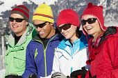 stock photo of middle-age  - Group Of Middle Aged Couples On Ski Holiday In Mountains - JPG