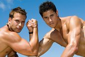 Muscled Men Under The Blue Sky