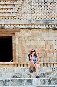 Young backpacker girl in Mayan ruins - Uxmal, Mexico