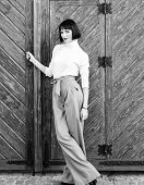 High Waisted Pants Fashion Trend. High Waisted Trousers. Woman Attractive Brunette Wear Fashionable  poster