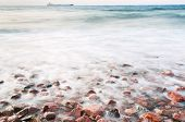 Cobble Stone Beach Of Read Sea On Sunset