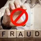A Man Holds A Red No Prohibition Symbol Over Word Fraud. Countering Deception, Protection Against Fr poster