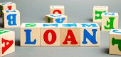 Wooden Blocks With The Word Loan. Consumer, Banking And Property Loan. Business And Entrepreneurial  poster