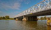 An Old Truss Bridge Over A Dutch River