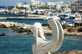 Greece, The Island Of Naxos.  The Main Harbour At Naxos Town. A Carved Statue Of A Sphinx. Blurred,  poster
