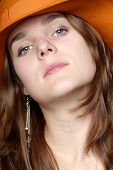 picture of bitchy  - young woman with silver earring and orange hat - JPG