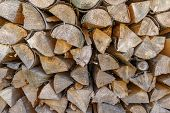 A Pile Of Stacked Firewood. Firewood Harvested For Heating In Winter. Chopped Firewood On A Stack. poster