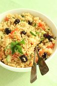 Bowl of quinoa tabbouleh salad with fresh mint