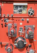 foto of firehose  - Valves and dials on an old vintage fire truck - JPG