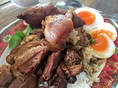 Rice With Pork Legs With Boiled Egg And Sweet Gravy Sauce Style Chinese Food In Dish On The Table, T poster