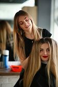 Woman Hairdresser Making Hairstyle For Girl Client. Hairstylist Styling Volume Haircut With Hands. F poster