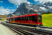 Famous Swiss Excursion Destination. Spectacular Travel And Touristic Place With High Mountains And S poster