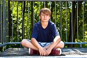 stock photo of transpiration  - young boy sweating and exhausted from sports - JPG