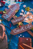 Road Sign With Adventure, Unknown And Quiet Life Directions. Travel Essentials Creative Flat Lay Wit poster