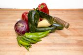 Various Vegetables On A Cutting Board Ready For Preparation To Cook. poster