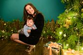 Baby With Mother At Christmas. Happy Family Mother And Baby Little Son Playing Home On Christmas Hol poster