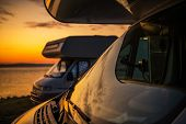 Rv Camper Vans Camping. Two Motorhomes And The Scenic Sunset. Closeup Photo. Summer Vacation On The  poster