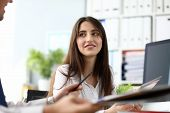 Portrait Of Gorgeous Female Sitting At Workplace And Looking At Someone With Gladness And Joy. Gorge poster