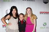 LOS ANGELES - APR 29:  Madison De La Garza, Mason Vale Cotton, Darcy Rose Byrnes arrives at the
