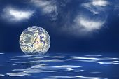 picture of geosphere  - The earth floating in an ocean to symbolize the melting of the polar ice caps - JPG