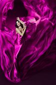 Woman In Violet Waving Silk Dress. Dancing.