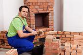 Masonry Worker Building Fireplace