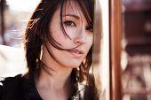 Young beautiful woman staring at camera.