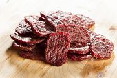 stock photo of marinade  - Dried Processed Beef Jerky against a background - JPG