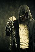 foto of post-apocalypse  - Merciless fighter of cruel post apocalyptic world with chains - JPG