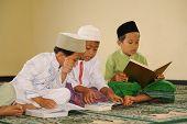 Muslim Kids Reading Koran