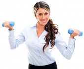 Businesswoman lifting weight in an active pause - isolated over white