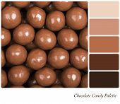 A colour palette with a background texture of milk chocolate candies with complimentary colour swatches.