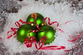 Green Xmas Ornaments With Snow And Garland