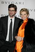LOS ANGELES - FEB 19:  Gale Harold, Sabina Belli arrive at the BVLGARI Celebrates Elizabeth Taylor's
