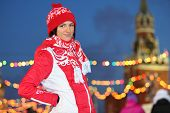 Smiling girl in red at GUM-Skating rink on Red Square in Moscow, Russia.