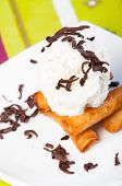 foto of lumpia  - fried custard wrapped lumpia wrapper topped with vanilla ice cream and shaved truffle chocolates - JPG