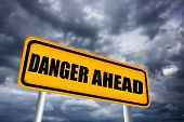 stock photo of hurricane clips  - Illustrated danger road sign over gloomy sky - JPG