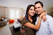 foto of quilt  - Young happy couple at bedroom - JPG