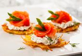 picture of buffet lunch  - Potato pancakes topped with smoked salmon - JPG