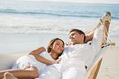 Peaceful couple relaxing on hammock at the beach