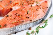 Salmon steak with thyme and pepper
