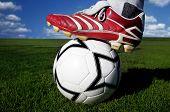 Horizontal image of soccer ball and shoes