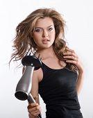 Brunette Woman Blow-drying Long Hair