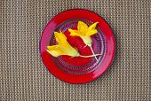 Two Zucchini Blossoms In Red Plate