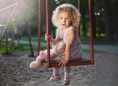Little girl on the swing.