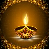 Indian festival of lights, Happy Diwali concept with illuminated floral decorated oil lit lamp on sh